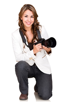 Photographer holding digital camera