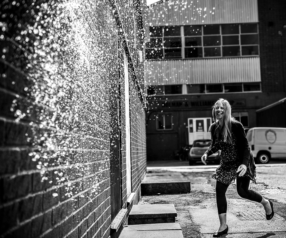water balloon exploading - fun exercises during beginners photography course in London